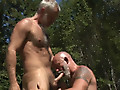 Backwoods Bears by Pantheon Productions features a sun-soaked outdoor blowjob with two horny, muscular bears sucking and stroking each other's hard dicks out in the woods, horny as hell.