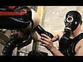 Rubclub 3 by BerlinStar Film features a gas mask and latex-clad couple getting down and dirty, squeezing a huge black dildo into a tight little horny ass, making his hard cock drip cum.