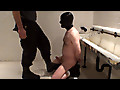 Iron Lockup: Kneeling on the wetroom floor, mostly naked except for boots, a hood and his chains