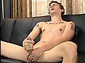 Trevor strokes a load out of his enormous uncut cock