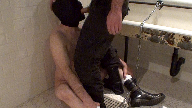 ManSurfer The prisoner patiently waits, chained to the urinal