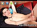 Aaron Aurora massaging his uncut cock